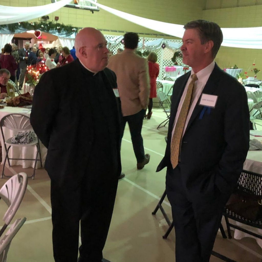 Kirk Walden and local Priest in New Iberia, LA